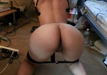 sexy asian babe bent over with her thong down