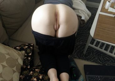 girlfriend bent over on couch with pants pulled slightly down
