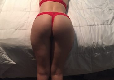 girlfriend bent over her bed in her hot red lingerie