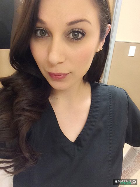 Selfie made by a sexy nurse in the hospital with her work outfit