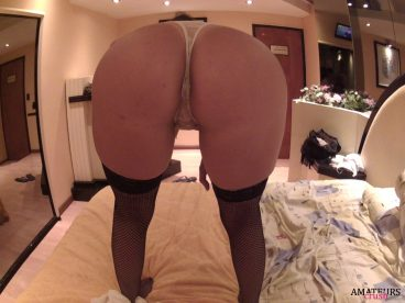 standing on bed and bending over with her big ass up close in amateur porn pics