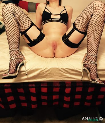 my sexy girlfriend pics by opening her legs on bed showing her juicy pussy in fishnet stockings and bra still on