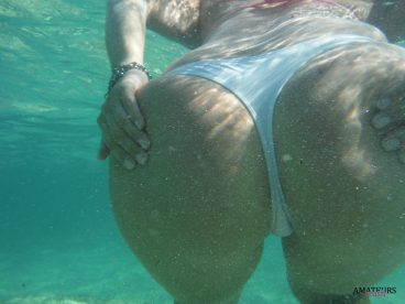 Girl grabbing her own amateur ass underwater in her white panties