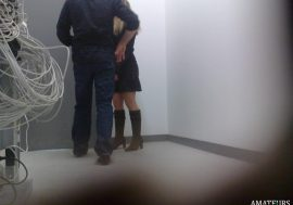 husband and wife sneaking into backroom