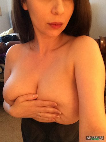 selfie of wife's covering her big juicy tits in her bedroom
