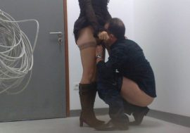 husband going down on wife in backroom of office