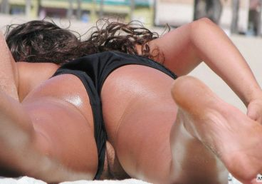 beach oops pussy slip through tight black bikini