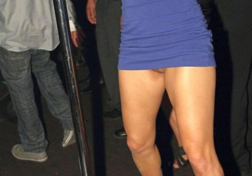 Tight blue dress too short and showing a oops pussy moment