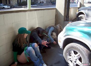 st patrick day girls peeing in public hiding against a high wall