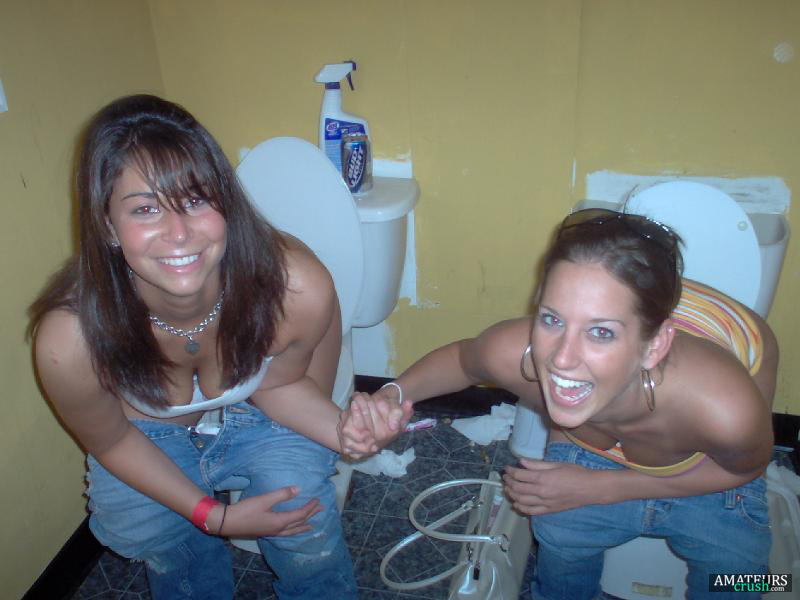 Two girls pissing in bathroom
