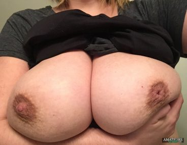 Ex-GF Holding on to her large breasts pics