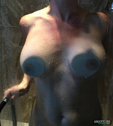 Huge tit pics pressed against the shower glass