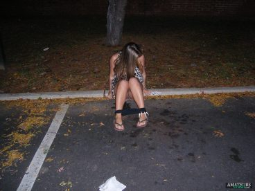 drunk college girl peeing outdoor in public