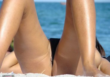 a nice close up of little pussy slip at the beach while tanning with her knees up