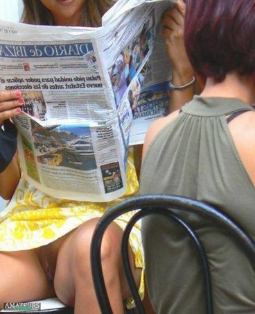 Sexy pussy slip in public of hot babe reading a newspaper