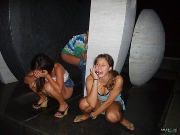drunk teens peeing in public from a night out