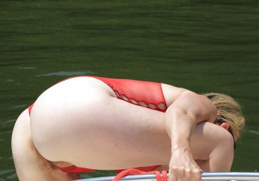 mature woman bent over on the boat having a vaginal slip