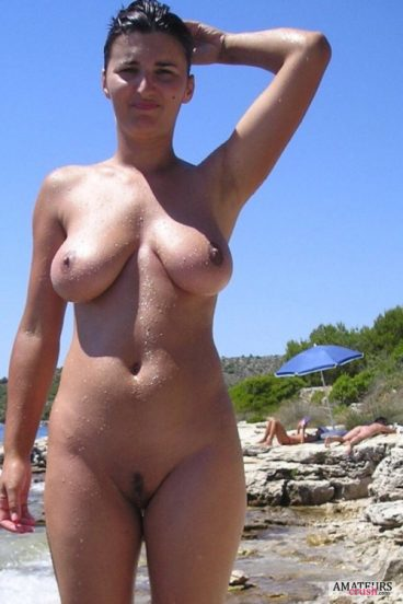 wet girlfriend showing off her big tits and gorgeous pussy in nude beach pic