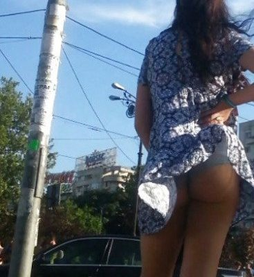 accidental upskirt caused by wind showing her amateur tight ass in public