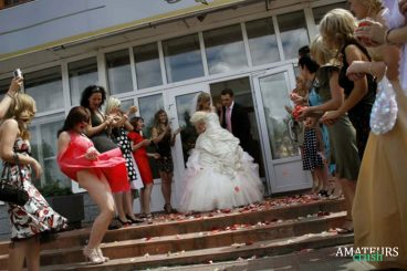bridemaids having oops upskirt while groom and bride is walking down the stairs