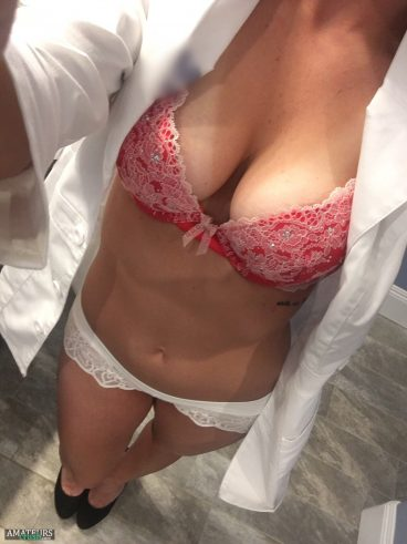 Naughty nurse wearing red sexy bra and white panties underneath doctor lab coat