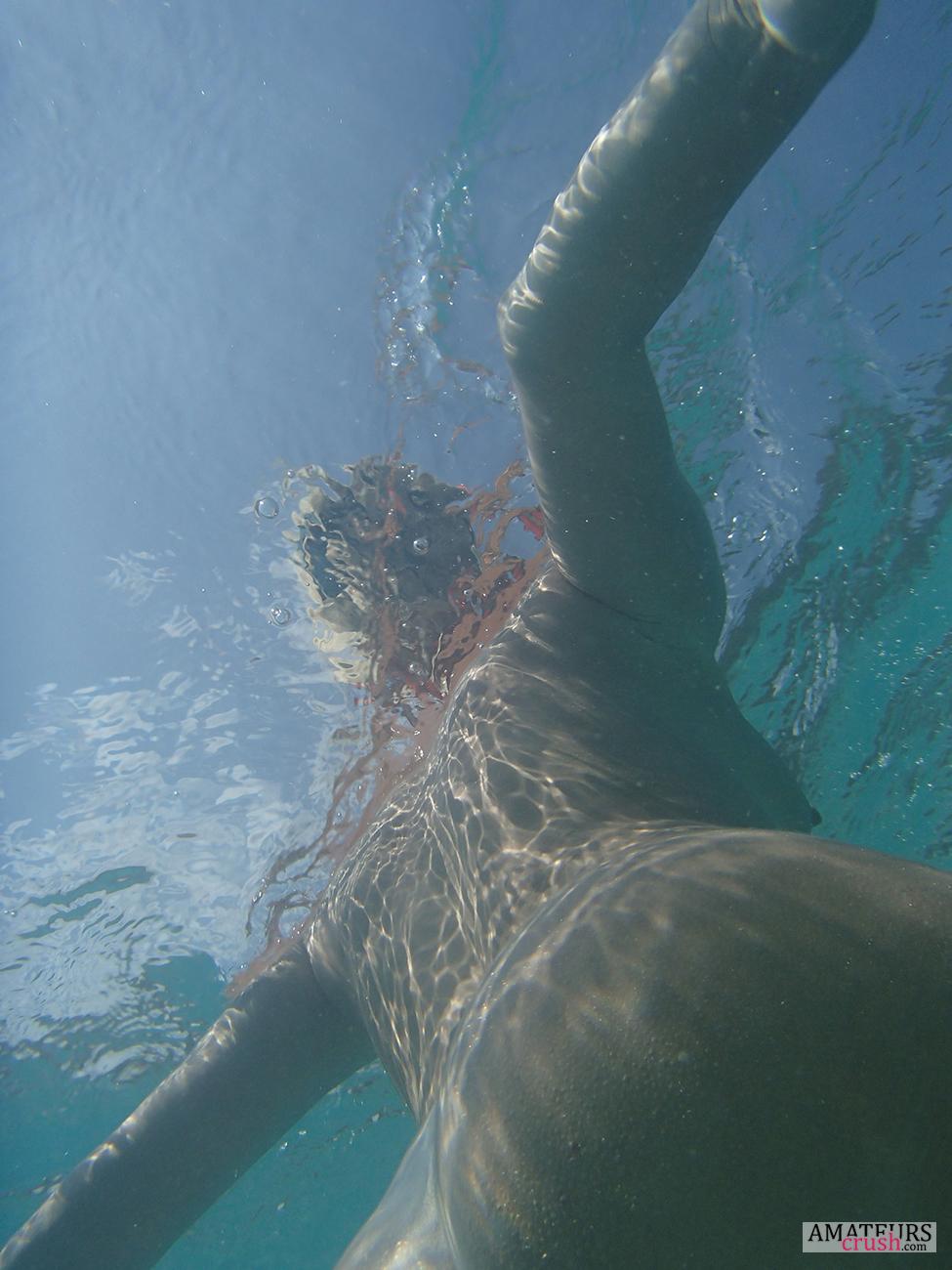 Underwater nude swimming