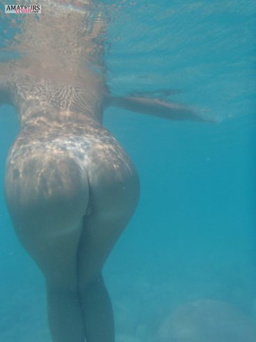 Underwater ass and pussy from behind of wife bent ovoer underwater big butt