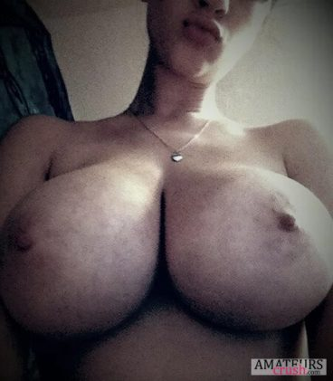 Close up of juicy big boobs hanging