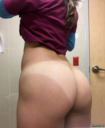 Big bubble butt with tan lines of naughty nurse showing off at work