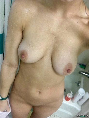Big titties of nude naughty nurse in the shower all wet and dripping selfie