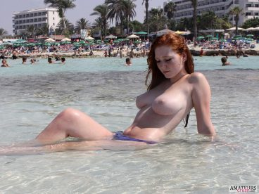 busty bare breasts ginger girl on the beach in the sea