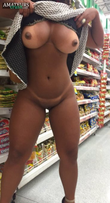 Ebony totally naked under her dress doing a public flash of her curvy booty