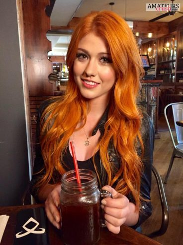 hottest redhead babe in a bar having a drink