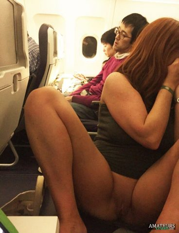Japanese girl flashing her beautiful pussy in public with her legs spread on a airplane