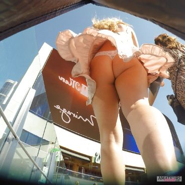 Windy upskirt of tight ass at the mall