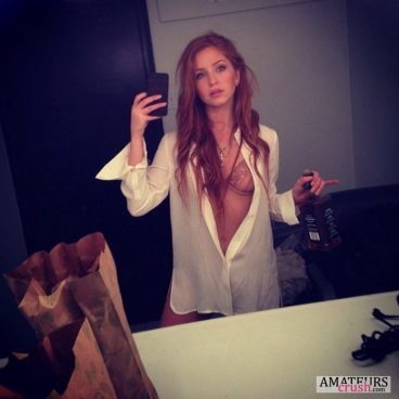 natural redhead morning selfie while holding jack daniels