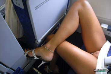 Pussy flash up skirt on airplane while seated