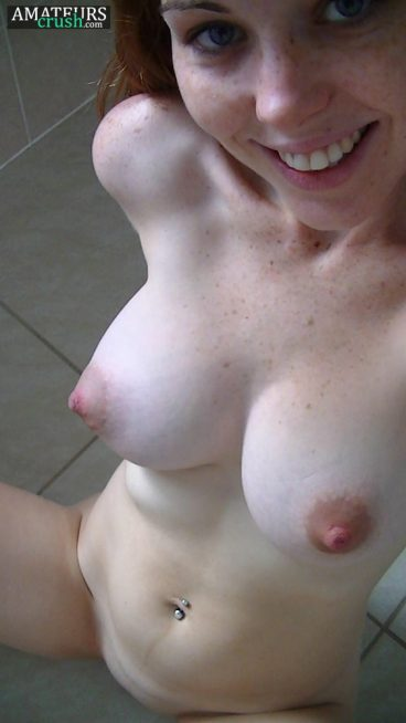 torpedo tits on redheads naked girl giving a big smile