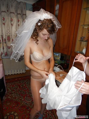 Sexy wife putting on wedding dress in hot lingerie picture