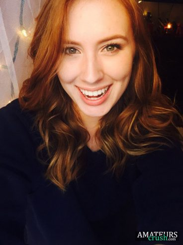 smiling beautiful ginger girl selfie in natural redhead