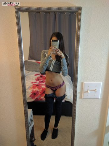 Pants slightly down showing her undies in teen selfie