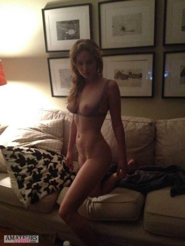 One leg off the couch with her beautiful sexy tits out of her top from Jlaw nudes