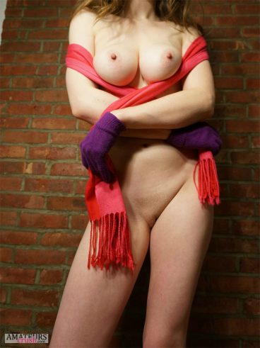 Sexy GF playing with her big boobs using her scarf in sexy strip tease teasing pic