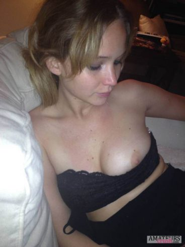 One boob out of bra while lying in bed with Jennifer Lawrence