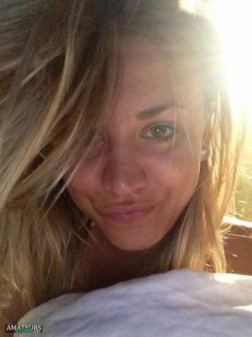 Kaley Cuoco leaked selfie of messy hair and duckface on bed
