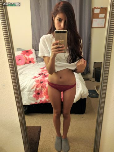 Teasing girl in her red panties selfie