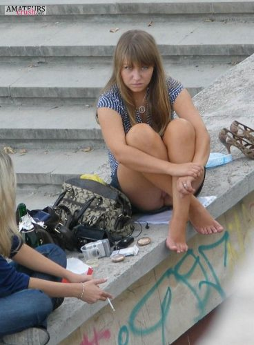 Caught while taking a candid upskirt pic of a college girl sitting on the ledge with her legs up