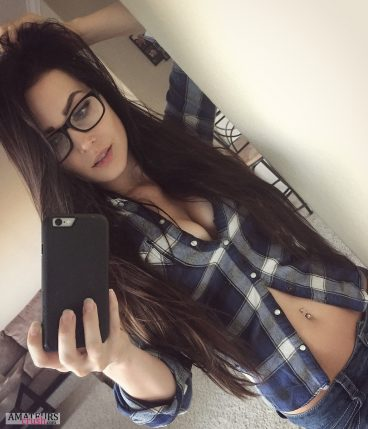 Big sexy cleavage of hot college girl wearing a blouse and glasses