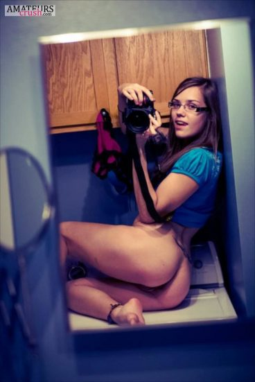 Cute girls with glasses going bottomless with her big ass on the counter selfie