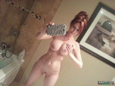 Natural redhead with big tits MILF in nude selfie